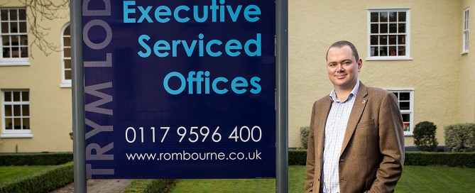 On Point Copywriting's Huw Bendon standing outside Trym Lodge, Bristol